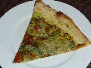 A slice of Dry River Company pesto pizza